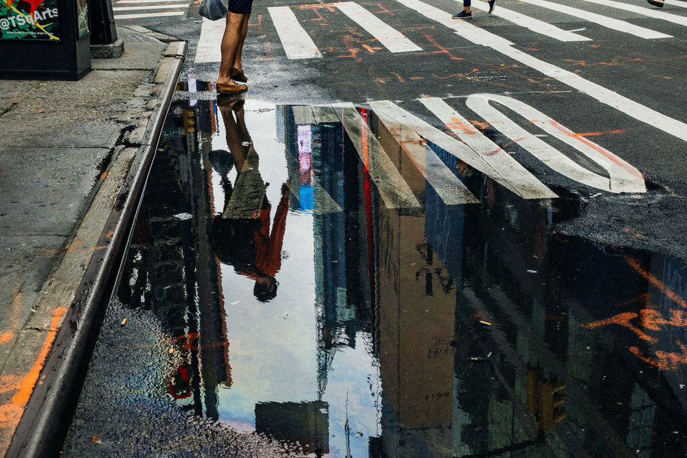 Reflections in the NYC streets.