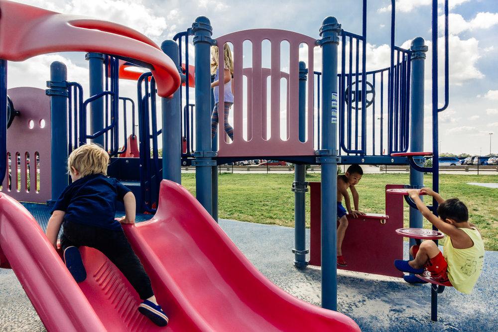 Playing on the playground at Jones Beach.