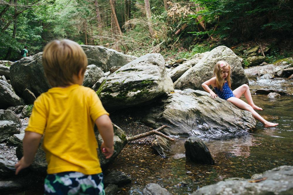 Siblings climb the rocks at Bash Bish Falls.