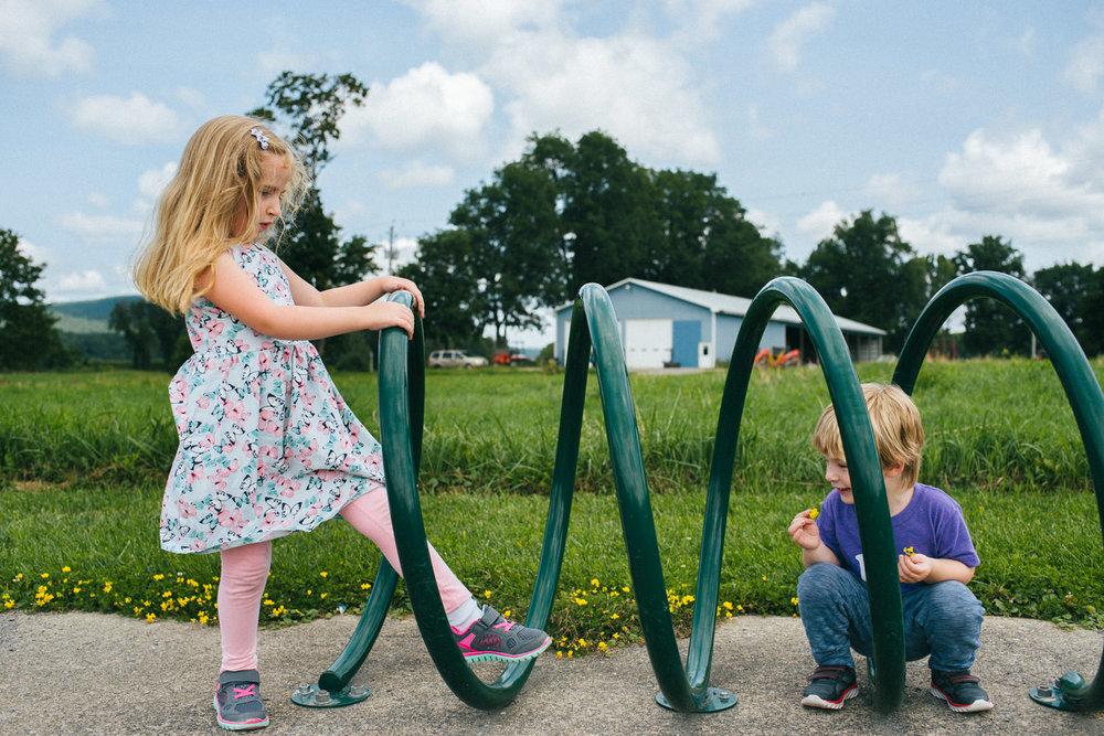 Kids play in a bike rack on the Rail Trail in Copake.