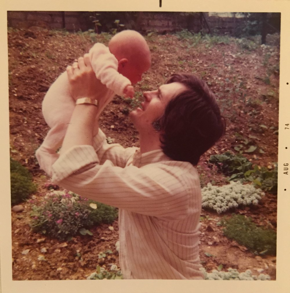 With my dad at 1 month old.