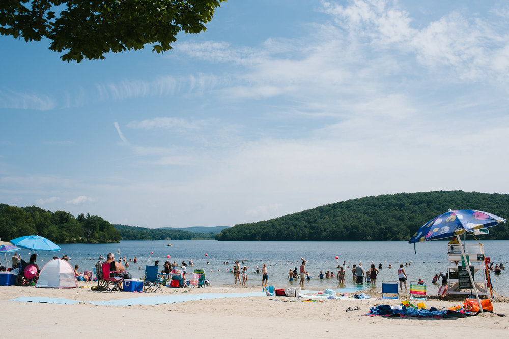 Beachgoers at Lake Taghkanic.