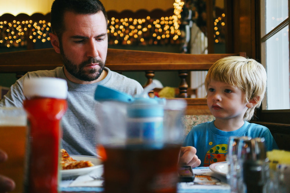 A father and son eat dinner at Four Brothers in Copake.