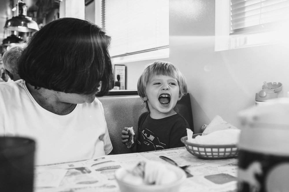 A little boy makes funny faces at the table at Dad's Diner in Copake.