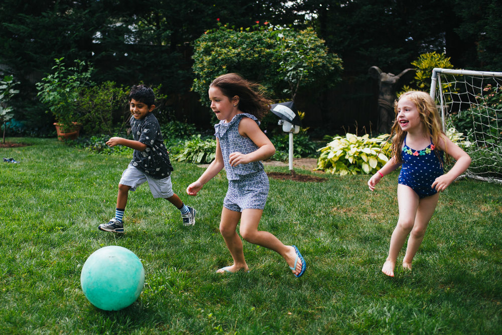 Kids play soccer.