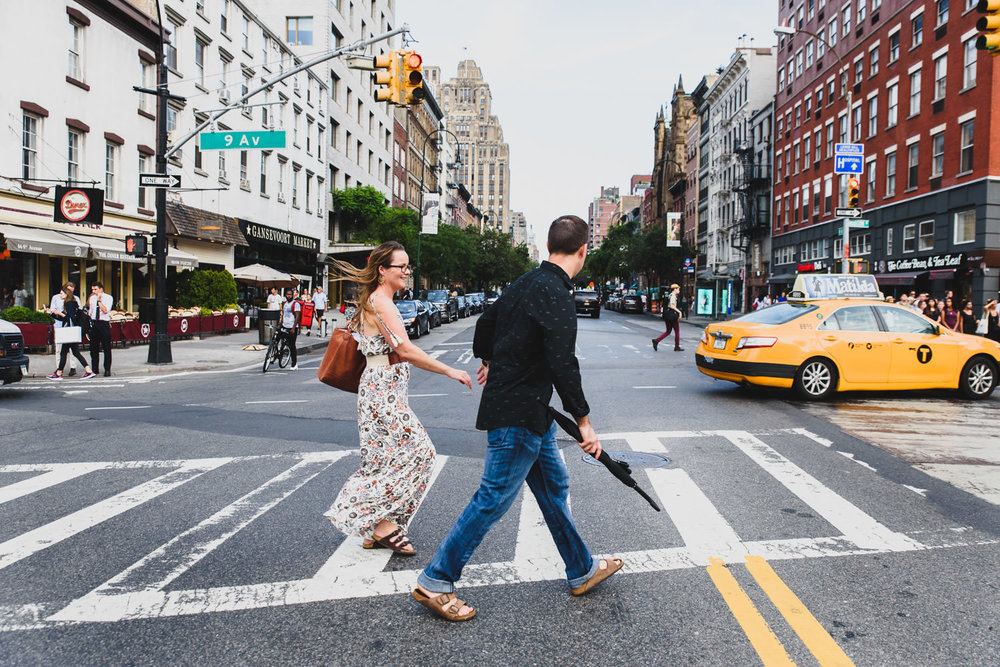 A couple crosses the street in New York City.