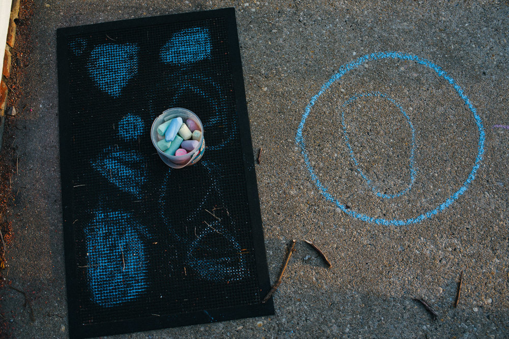 Sidewalk chalk and children's drawings.