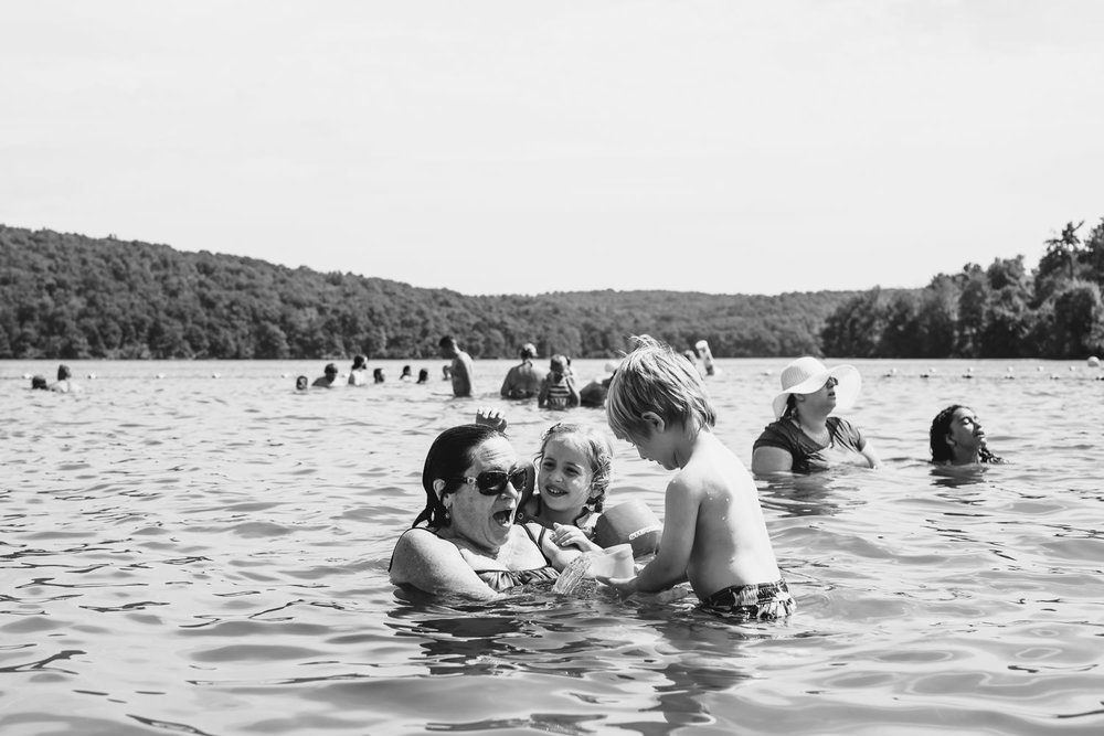 Kids play with their grandmother in Lake Taghkanic.