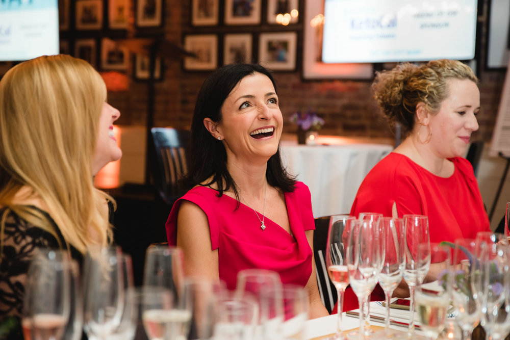 Women laugh at an event at the Farmer and the Fish.