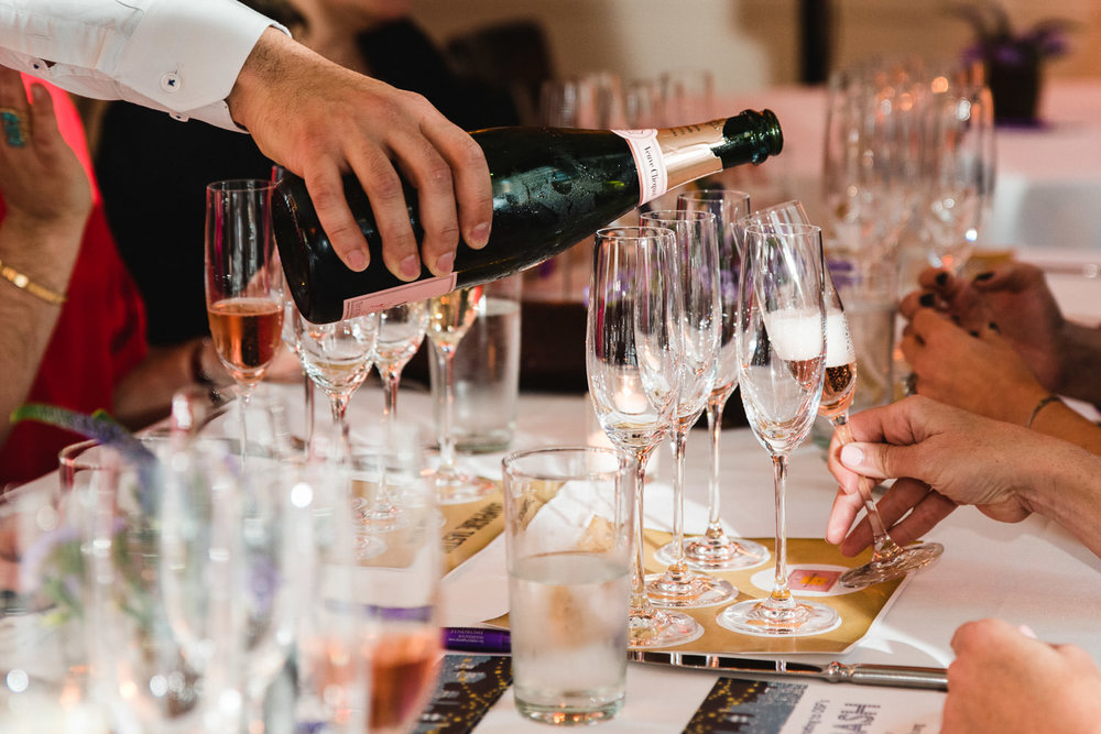 Champagne being poured into glasses.