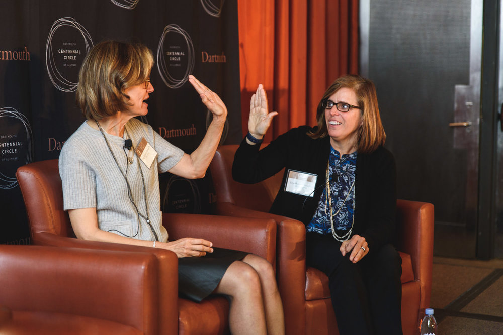 Women high five at an event for Dartmouth.