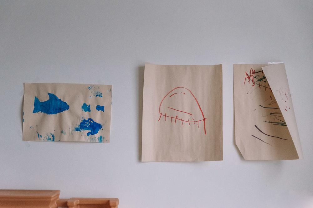 Children's artwork hangs on the walls.