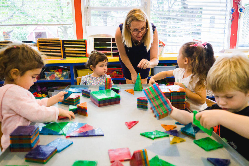 Kids play with Magnatiles at their preschool.