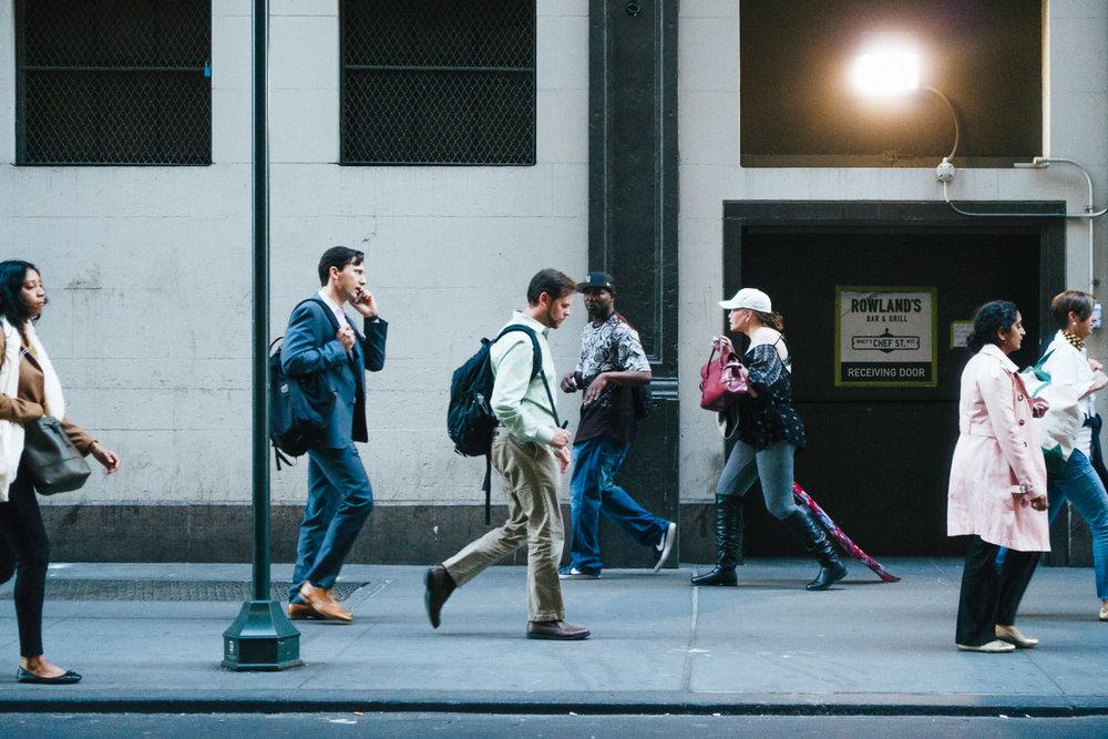 People walking down the street in NYC.