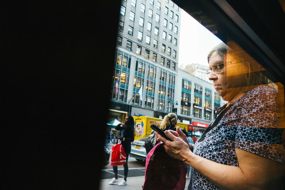 A woman looks at her cell phone in NYC.