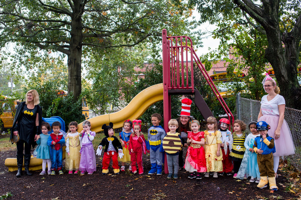 A preschool class in their costumes for Halloween.