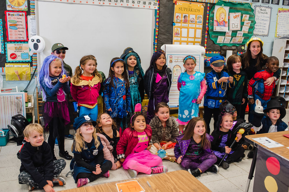 A kindergarten class celebrates Halloween.