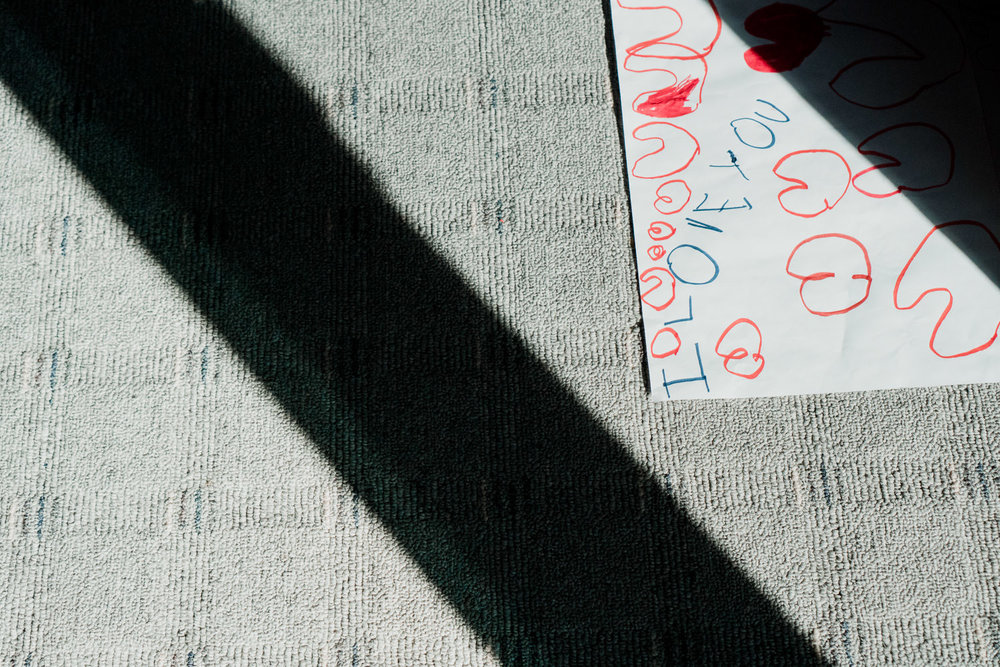 A child's drawing hidden in the shadows.