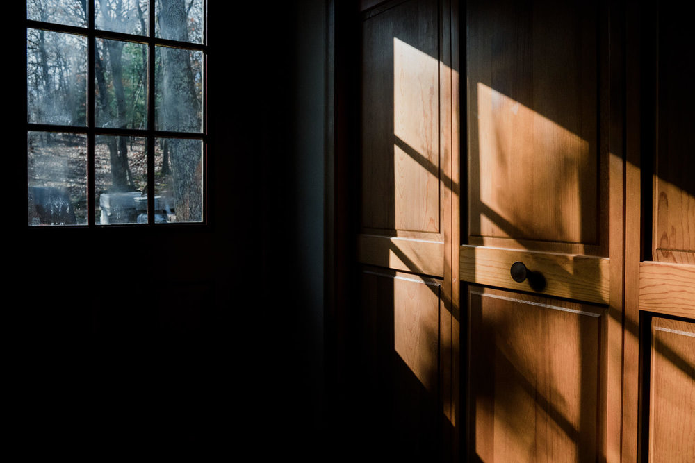 Light and shadow shine in the side door.