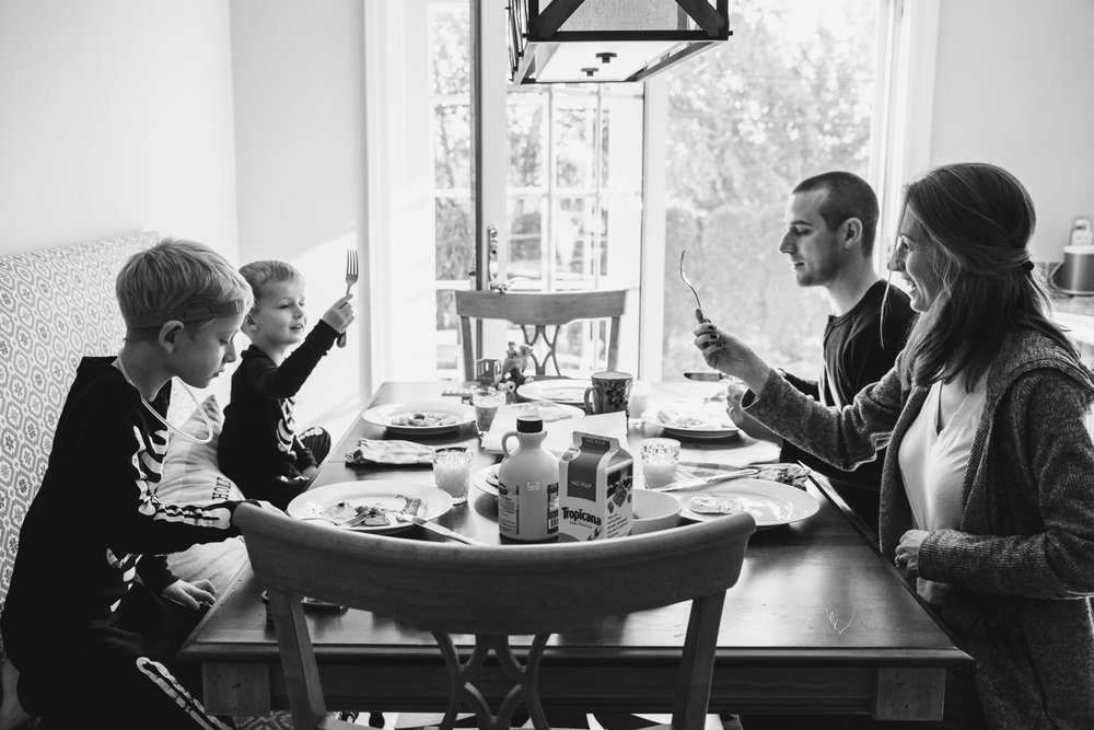 A family eats breakfast together.