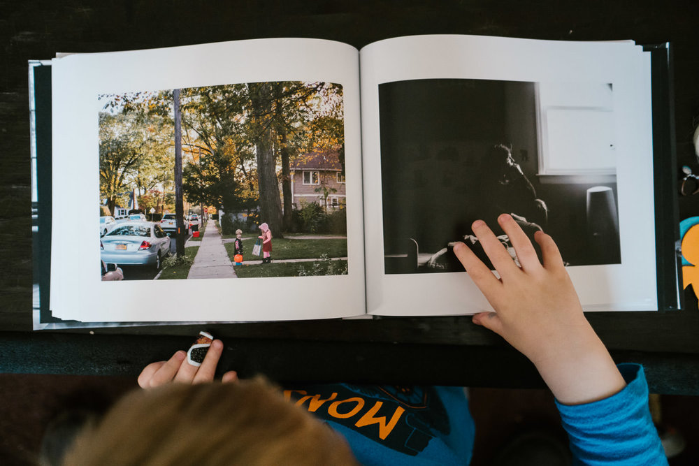 A little boy looks through a photo album.
