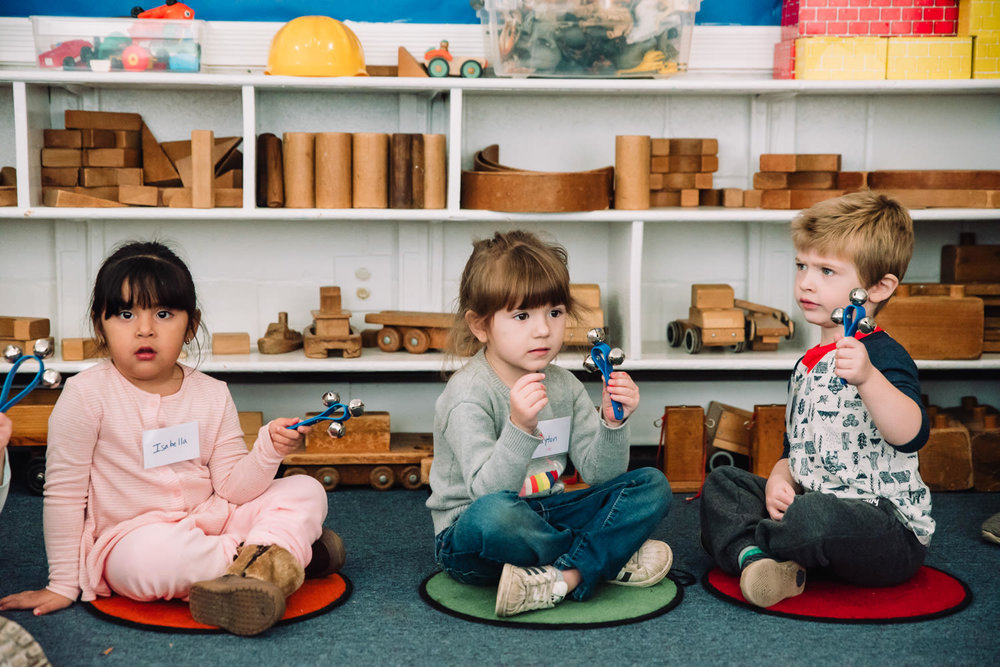 Kids play musical instruments at nursery school.