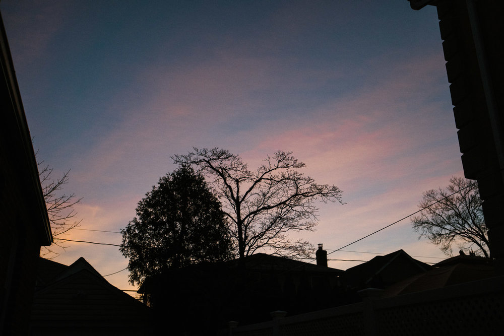 Pretty pink sunrise above the rooftops.