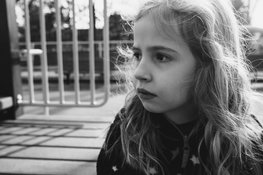 A portrait of a little girl at the playground.