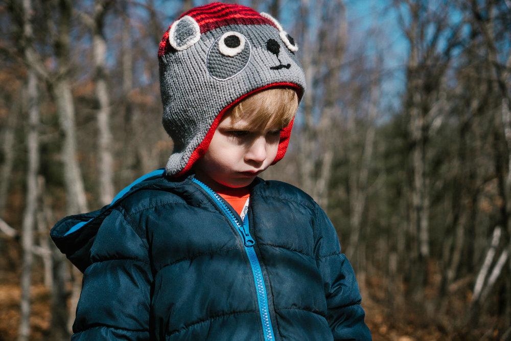 A little boy bundled up in winter wear.