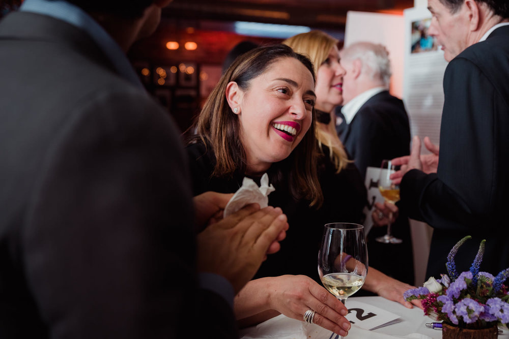 A woman laughs at an event for the Dravet Foundation.