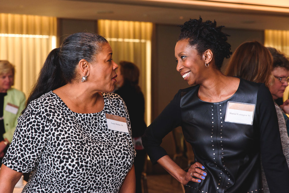Women chat at an event for Dartmouth College.