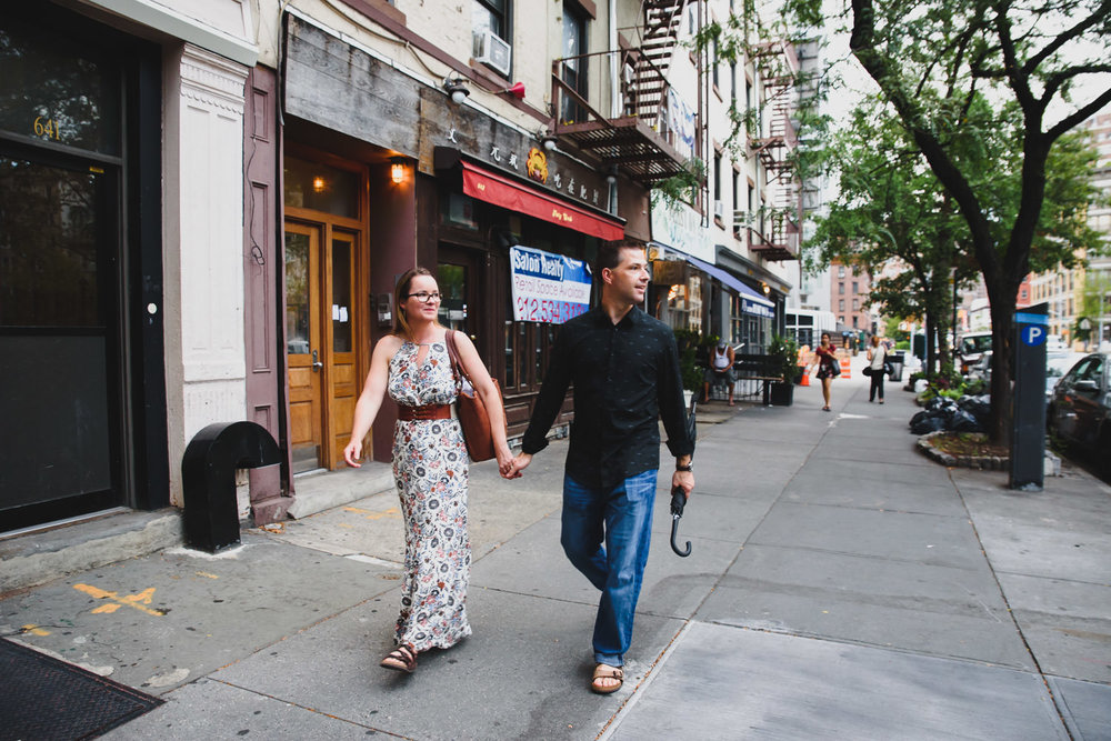 A couple walks down the street in the West Village.