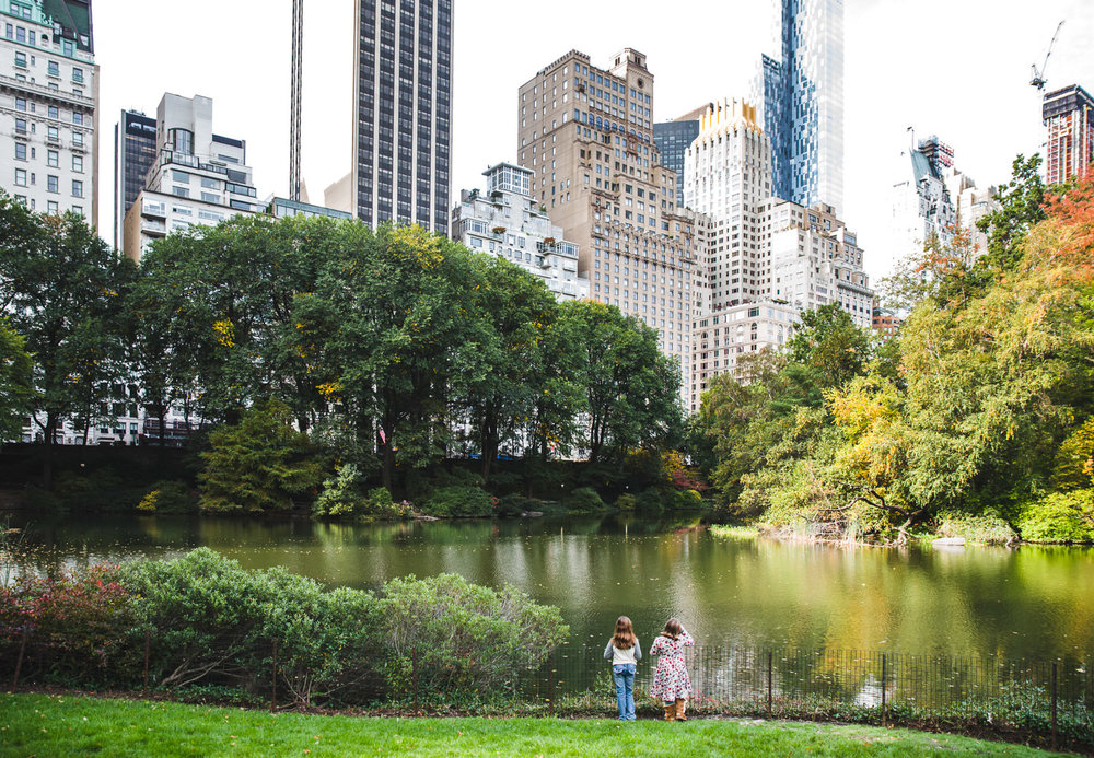 Two girls play in Central Park.