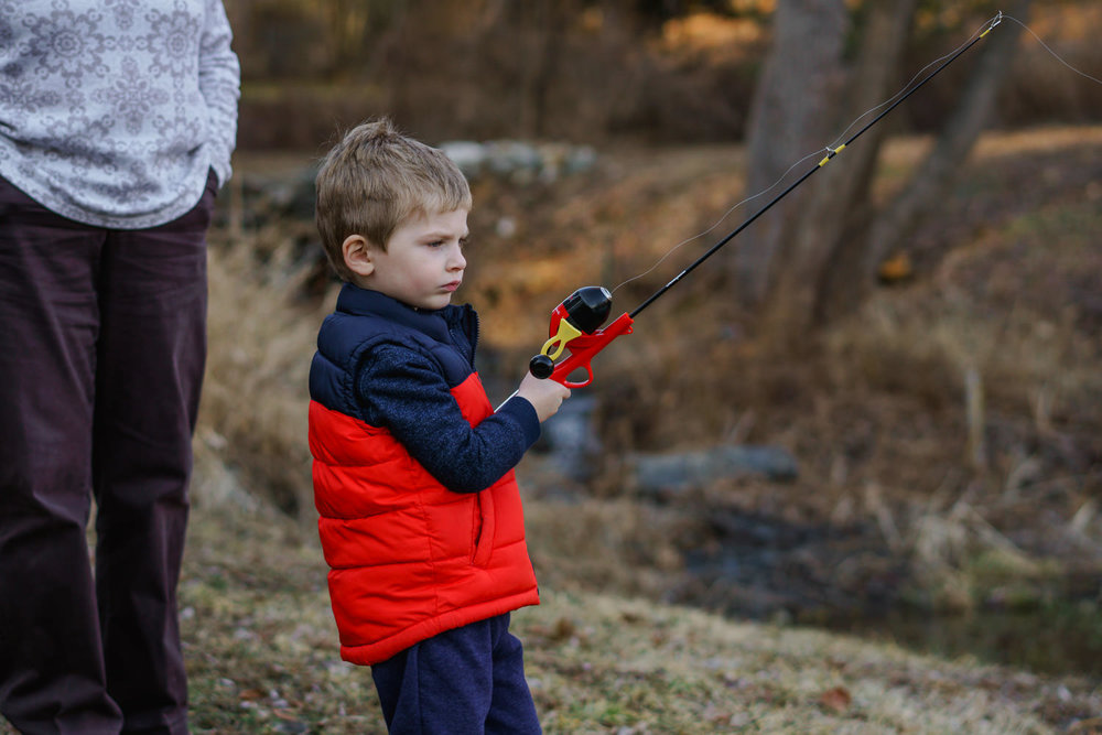 A little boy fishes.