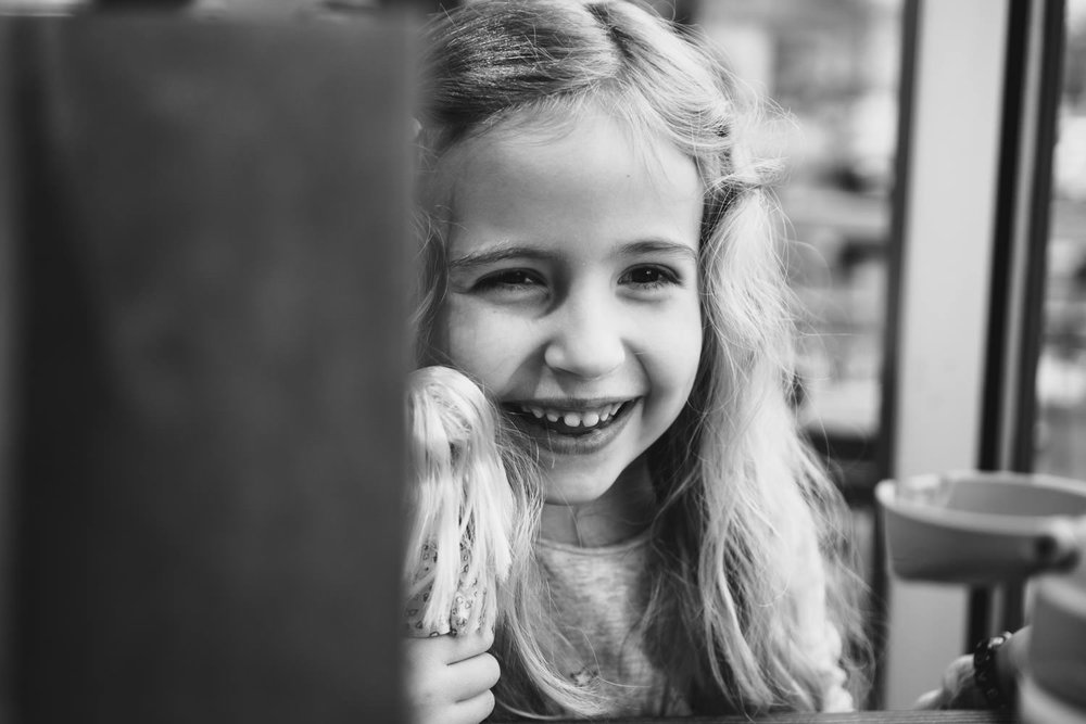 A little girl laughs at Shake Shack.