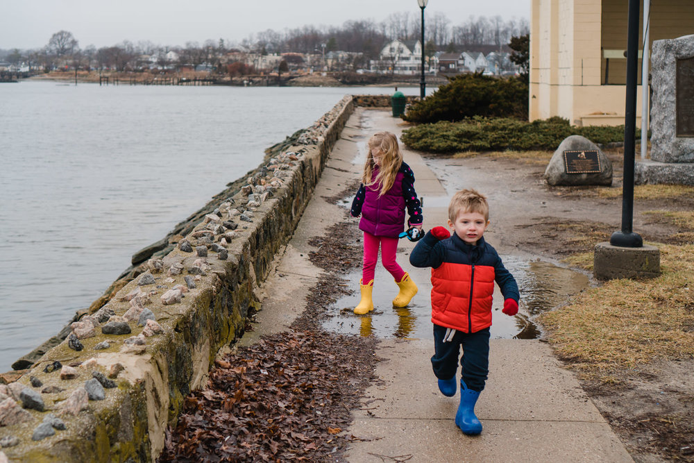 Two kids walk along the waterfront in Port Washington.