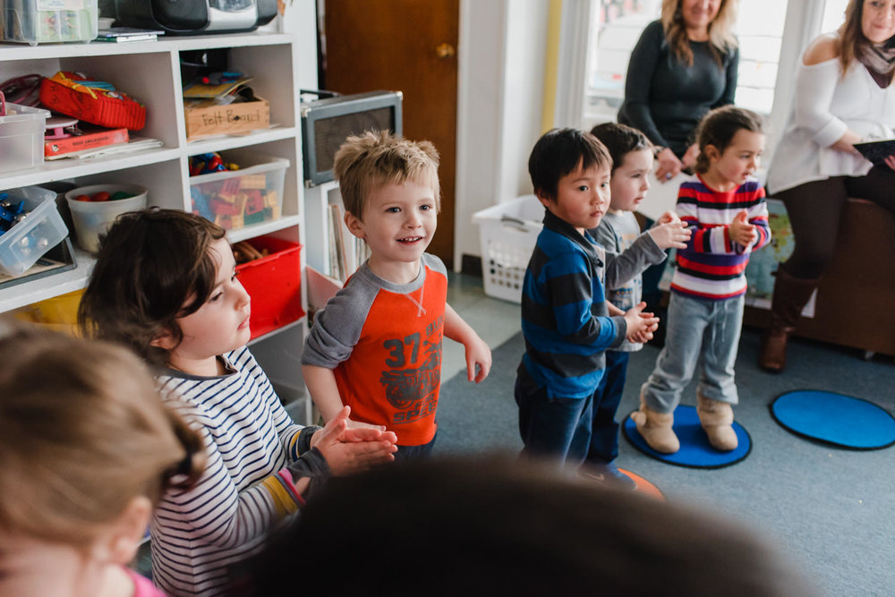 Preschoolers dance during circle time.