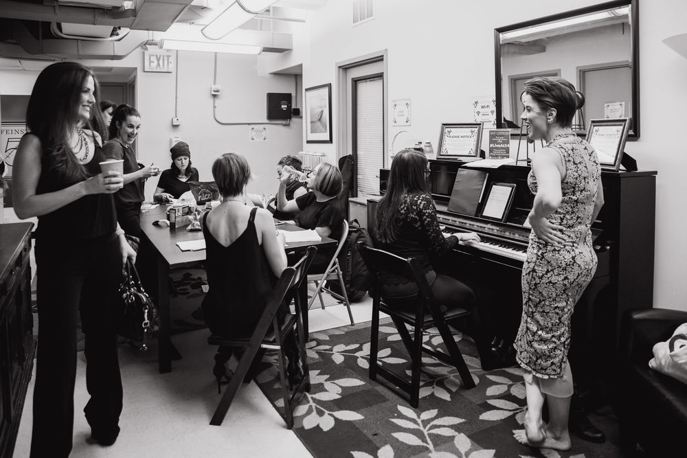 Broadway singers warm up before a concert at 54 Below.