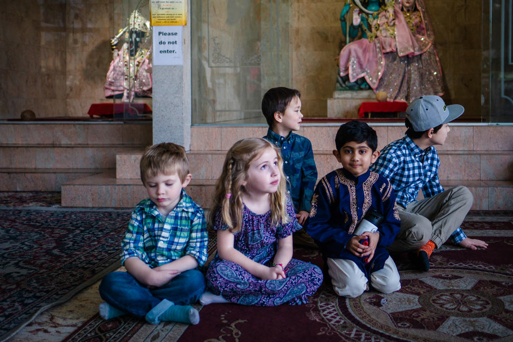 Kids sit on a carpet at a Vedic temple in Hempstead, NY.