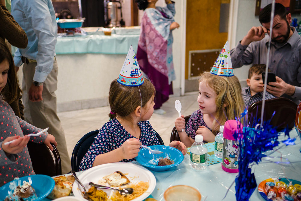 Children eat birthday cake at a party.
