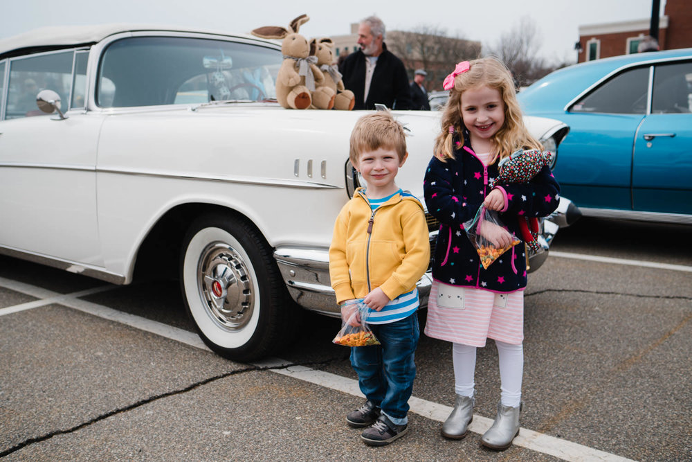 Two children pose for a picture at the Garden City Car Show.