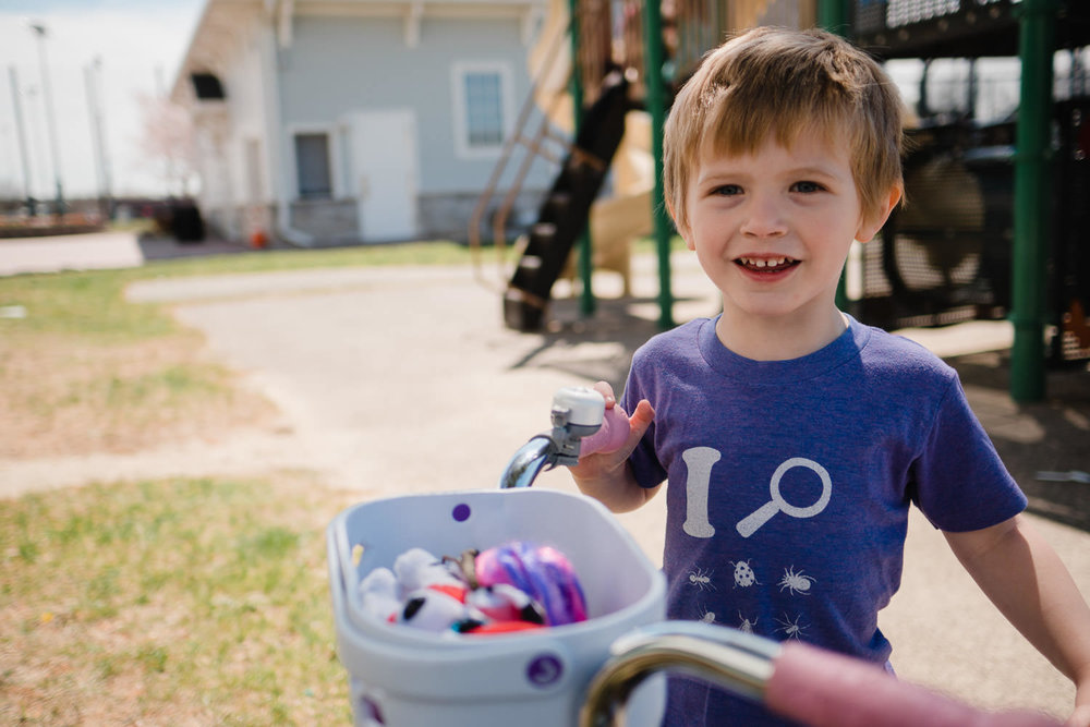 A little boy smiles at the playground at Garden City Community Park.