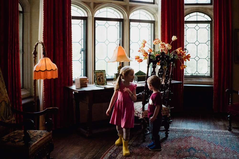 Children explore Coe House at Planting Fields.