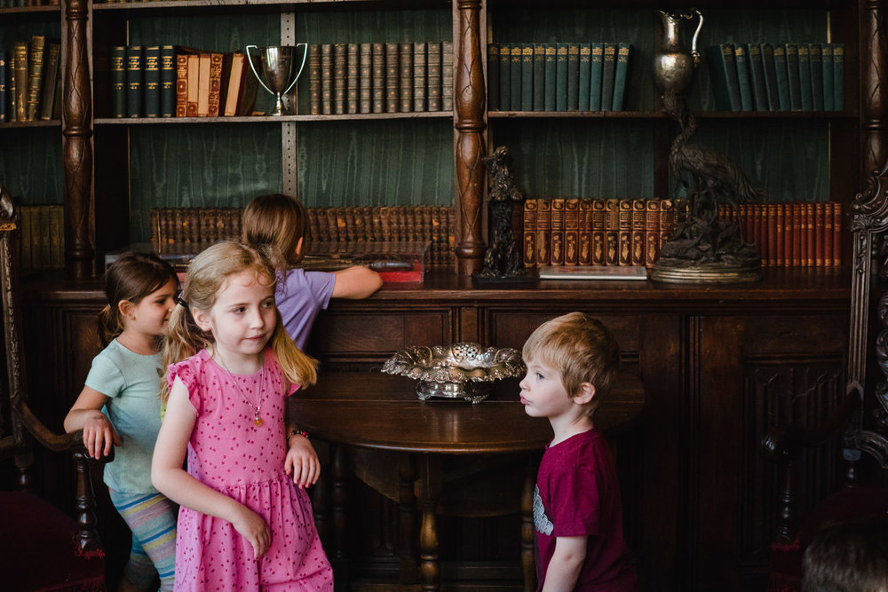 Children play in the study at Coe House.