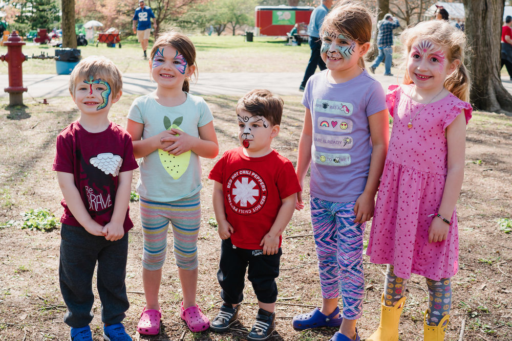 Children with painted faces at Arbor Day Festival.