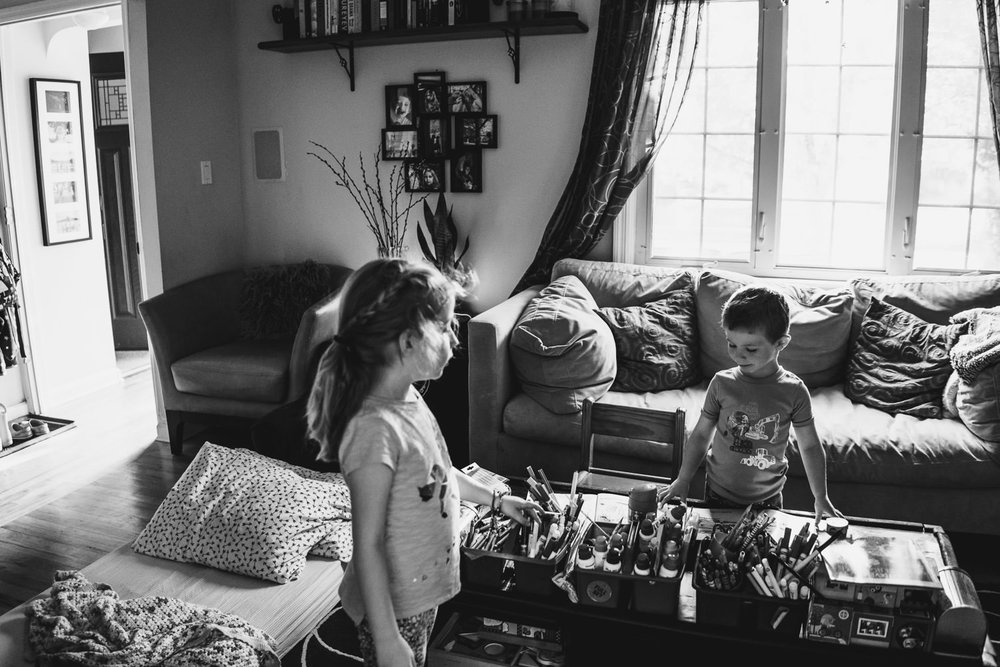 Two children play in their living room.