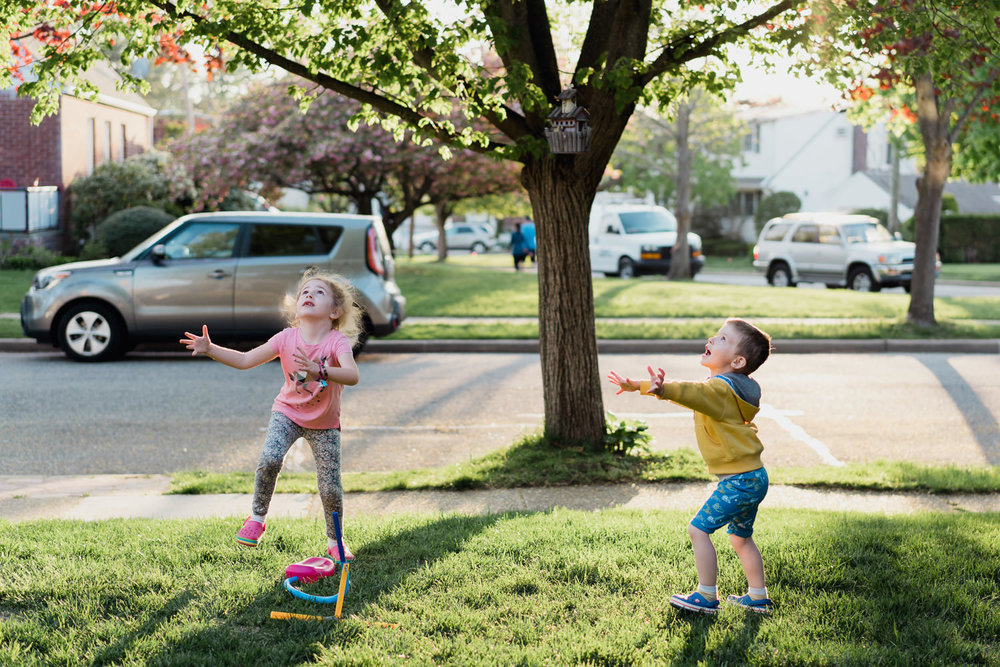 Two children play with a stomp rocket.