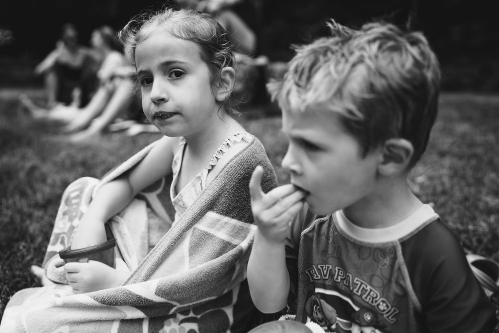 Two kids eat snacks at the Ore Pit.