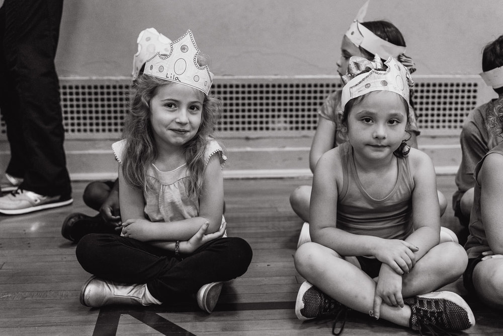 Two girls with paper crowns.