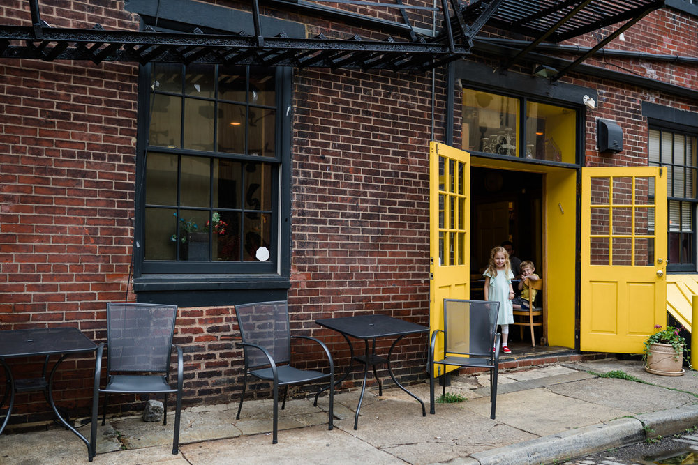 Children stand in a doorway of a cafe in Philadelphia.